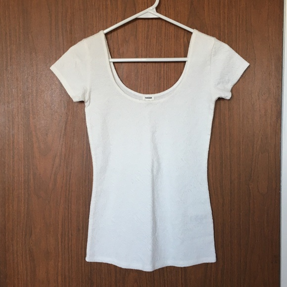 White low cut Garage t shirt.